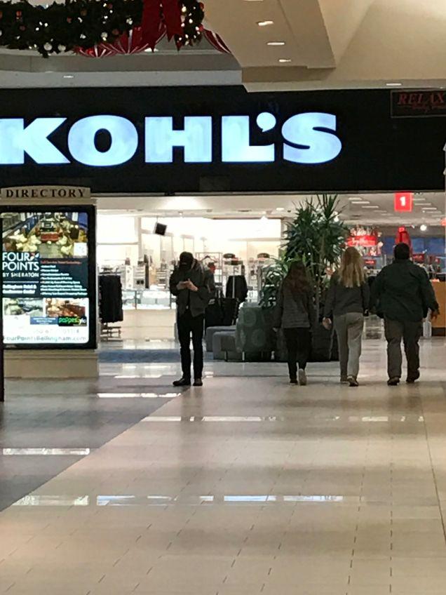 Family of three walking at Bellis Fair Mall